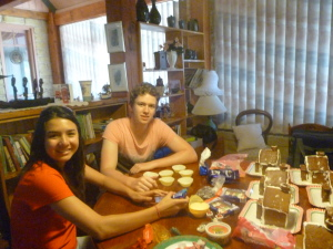 Nic with his girlfriend Sarah cementing the gingerbread houses