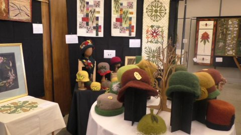 Felt hats and wall hangings at quilt exhibition
