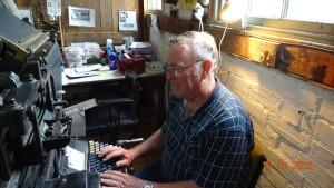 Robert operating the type setter